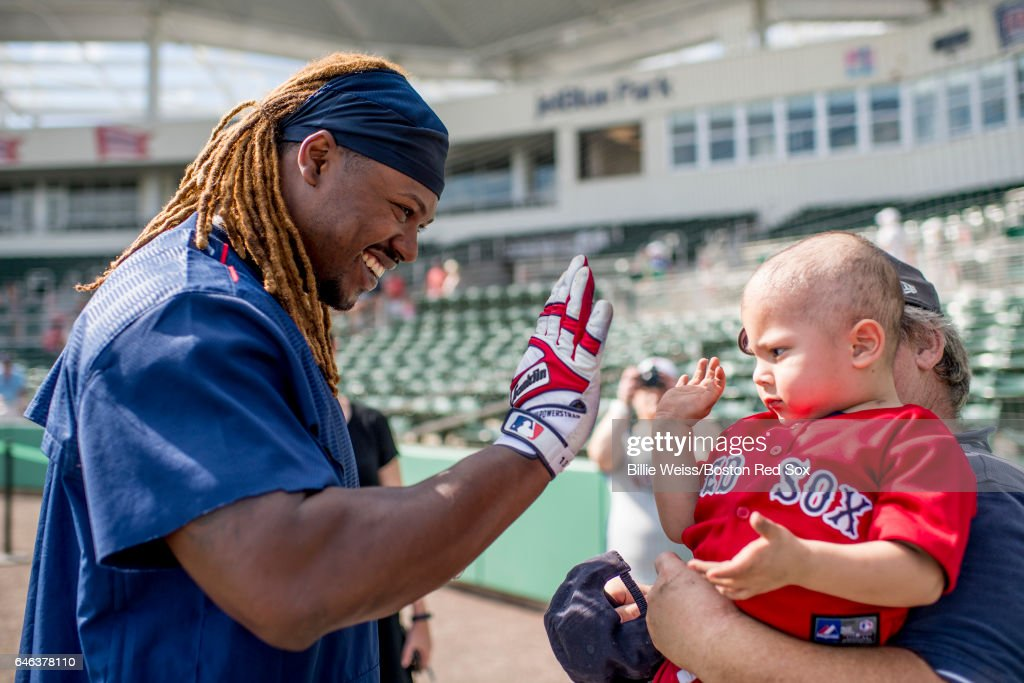 Hanley Ramirez #13 of the Boston Red Sox greets a young fan before a Spring Training game against the New York Yankees on February 28, 2017 at Fenway South in Fort Myers, Florida .