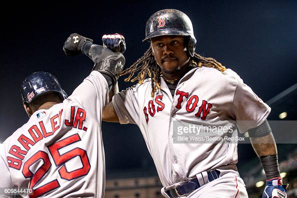 Hanley Ramirez of the Boston Red Sox high fives Jackie Bradley Jr #25 after hitting a solo home run during the seventh inning of a game against the...