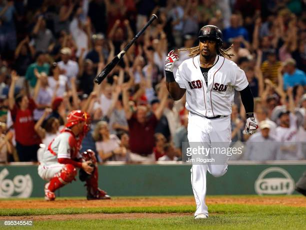 Hanley Ramirez of the Boston Red Sox hits a gametying home run against the Philadelphia Phillies in the eighth inning at Fenway Park on June 12 2017...