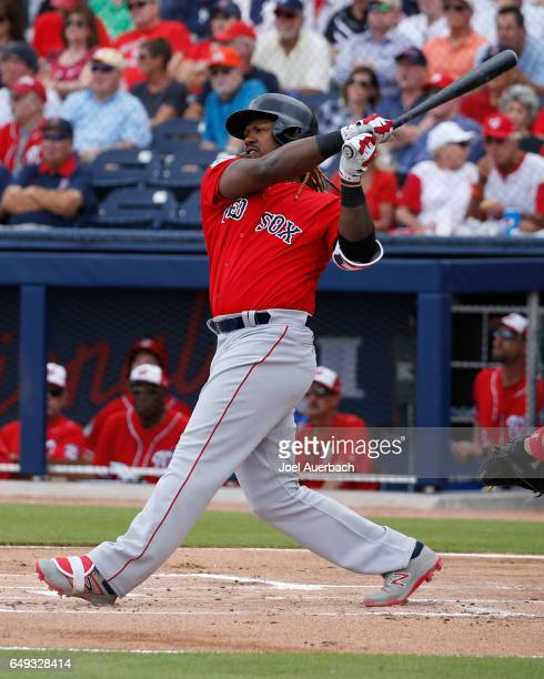 Hanley Ramirez of the Boston Red Sox hits a solo home run against the Washington Nationals in the first inning during a spring training game at The...