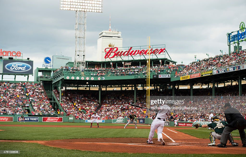 Hanley Ramirez of the Boston Red Sox hits a tworun home run during the first inning against the Oakland Athletics at Fenway Park in Boston...