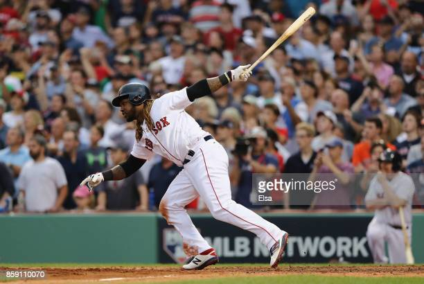 Hanley Ramirez of the Boston Red Sox hits a tworun RBI double in the seventh inning against the Houston Astros during game three of the American...