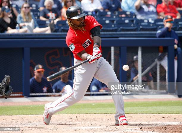 Hanley Ramirez of the Boston Red Sox hits the ball against the Houston Astros in the third inning during a spring training game at The Ballpark of...