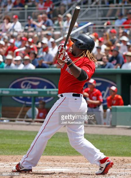 Hanley Ramirez of the Boston Red Sox hits the ball against the Washington Nationals in the fourth inning during a spring training game at JetBlue...