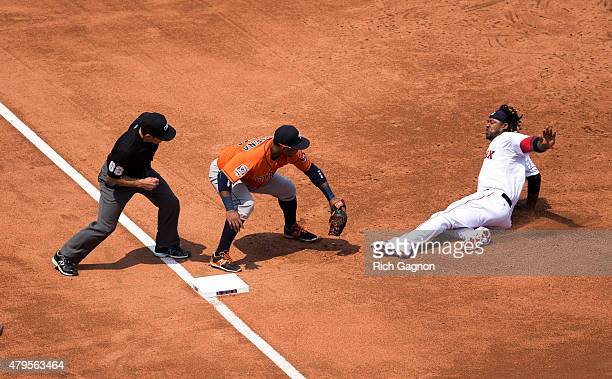 Hanley Ramirez of the Boston Red Sox is tagged out at third base by Luis Valbuena of the Houston Astros on a throw by center fielder Jake Marisnick...