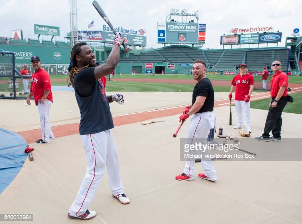 Hanley Ramirez of the Boston Red Sox jokes with Christian Vazquez before a game against the Toronto Blue Jays at Fenway Park on July 18 2017 in...