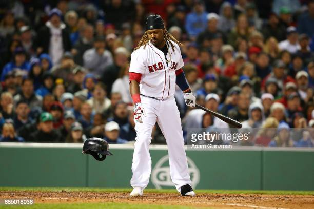 Hanley Ramirez of the Boston Red Sox loses his helmet after striking out in the sixth inning of a game against the Chicago Cubs at Fenway Park on...