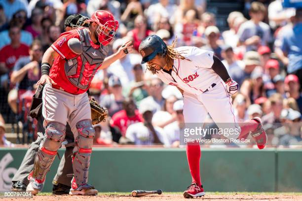 Hanley Ramirez of the Boston Red Sox reacts after being hit by a pitch during the third inning of a game against the Los Angeles Angels of Anaheim on...