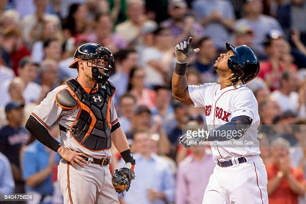 Hanley Ramirez of the Boston Red Sox reacts after hitting a three run home run as Matt Wieters of the Baltimore Orioles looks on during the third...