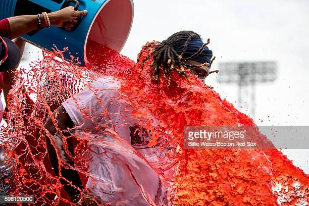 Hanley Ramirez of the Boston Red Sox reacts as he is given a Powerade bath after a game against the Tampa Bay Rays on August 31 2016 at Fenway Park...