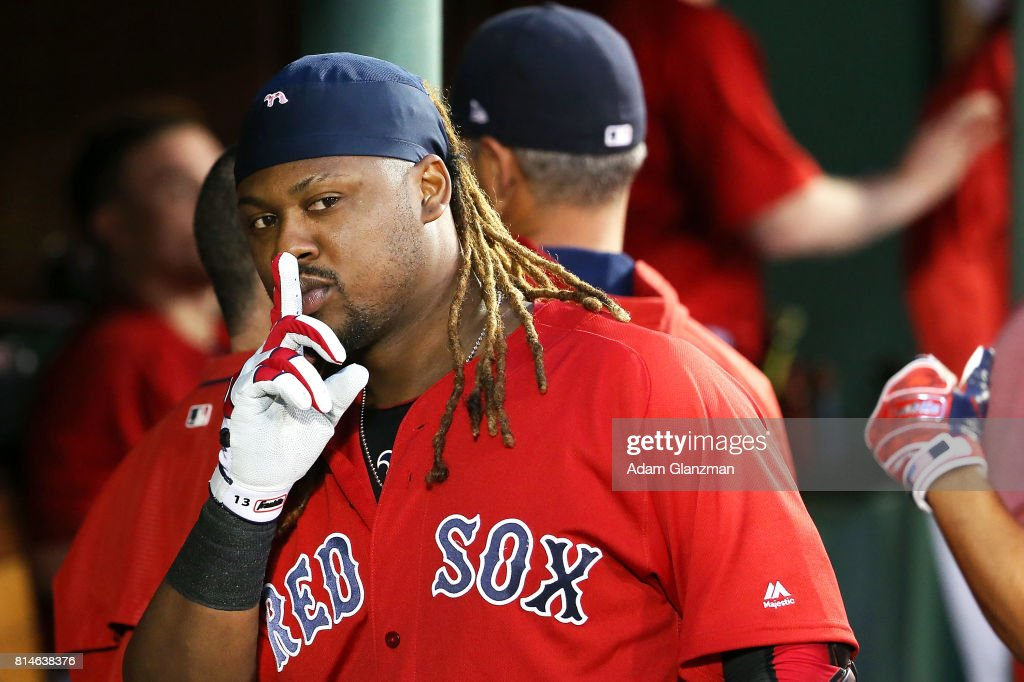 Hanley Ramirez #13 of the Boston Red Sox returns to the dugout after hitting a two-run home run in the third inning of a game against the New York Yankees at Fenway Park on July 14, 2017 in Boston, Massachusetts.
