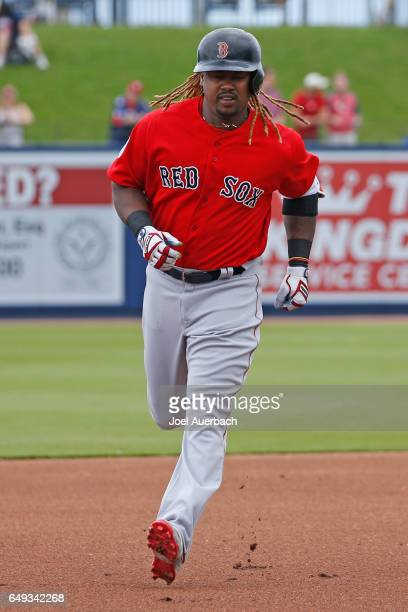 Hanley Ramirez of the Boston Red Sox rounds the bases after hitting a home run against the Washington Nationals in the first inning during a spring...