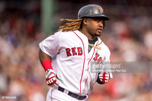 Hanley Ramirez of the Boston Red Sox rounds the bases after hitting a solo home run during the third inning of a game against the Chicago Cubs on...