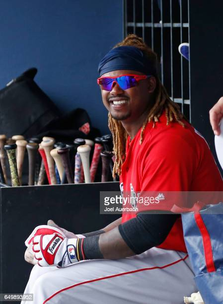 Hanley Ramirez of the Boston Red Sox sits in the dugout prior to the spring training game against the Washington Nationals at The Ballpark of the...