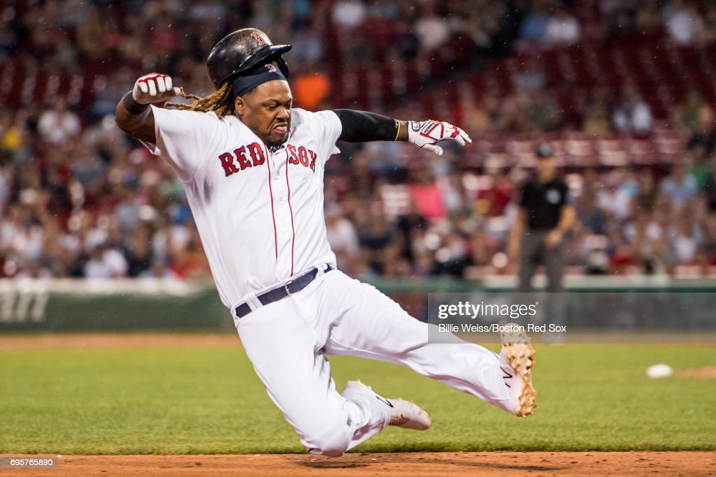 Hanley Ramirez #13 of the Boston Red Sox slides into third base during the eleventh inning of a game against the Philadelphia Phillies on June 13, 2017 at Fenway Park in Boston, Massachusetts.