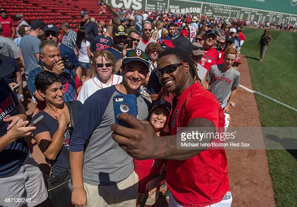 Hanley Ramirez of the Boston Red Sox takes a selfie with a fan during a player photo fan appreciation event before a game against the Philadelphia...