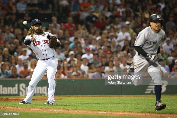 Hanley Ramirez of the Boston Red Sox throws the ball to first base as Ronald Torreyes of the New York Yankees runs in the eighth inning of a game at...