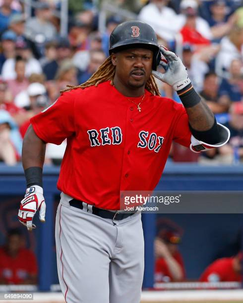 Hanley Ramirez of the Boston Red Sox walks to first base against the Washington Nationals in the fourth inning during a spring training game at The...
