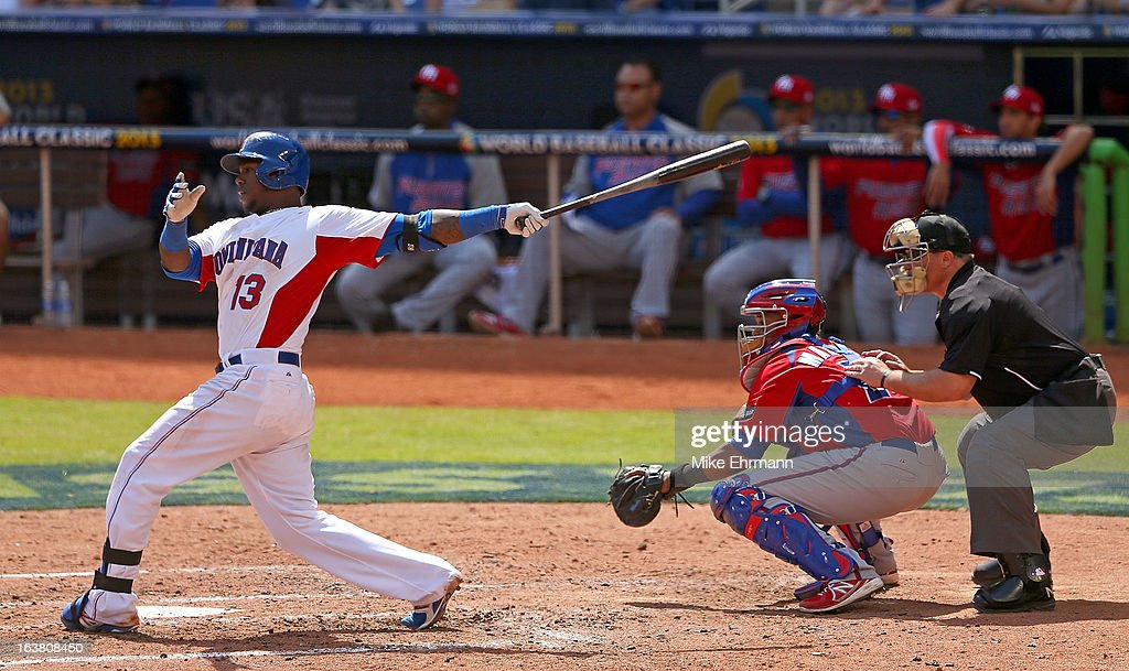 <a gi-track='captionPersonalityLinkClicked' href=/galleries/search?phrase=Hanley+Ramirez&family=editorial&specificpeople=538406 ng-click='$event.stopPropagation()'>Hanley Ramirez</a> #13 of the Dominican Republic hits during a World Baseball Classic second round game against Puerto Rico at Marlins Park on March 16, 2013 in Miami, Florida.