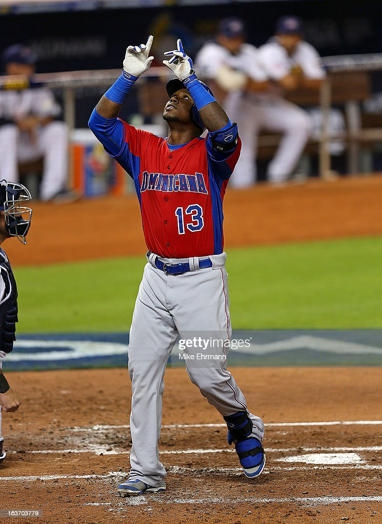<a gi-track='captionPersonalityLinkClicked' href=/galleries/search?phrase=Hanley+Ramirez&family=editorial&specificpeople=538406 ng-click='$event.stopPropagation()'>Hanley Ramirez</a> #13 of the Dominican Republic is celebrates after a solo home run during a World Baseball Classic second round game against the USA at Marlins Park at Marlins Park on March 14, 2013 in Miami, Florida.