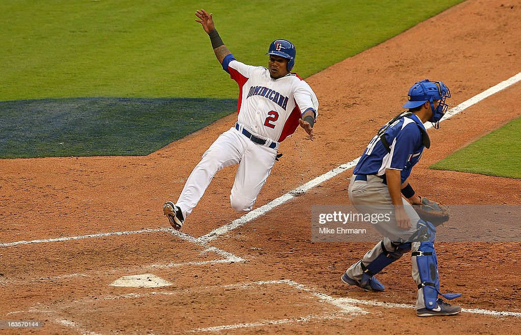 <a gi-track='captionPersonalityLinkClicked' href=/galleries/search?phrase=Hanley+Ramirez&family=editorial&specificpeople=538406 ng-click='$event.stopPropagation()'>Hanley Ramirez</a> #2 of the Dominican Republic scores during a World Baseball Classic second round game against Italy at Marlins Park on March 12, 2013 in Miami, Florida.