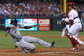 Hanley Ramirez of the Florida Marlins slides safe into home in front of Carlos Ruiz of the Philadelphia Phillies on September 7 2010 at Citizens Bank...