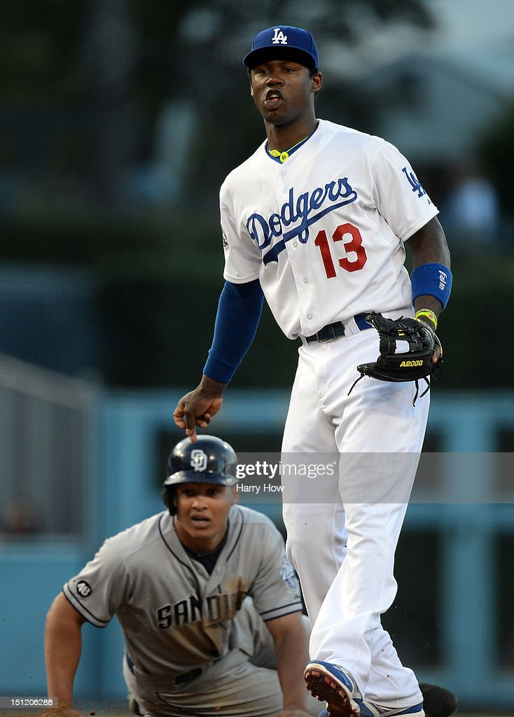Hanley Ramirez #13 of the Los Angeles Dodgers and Will Venable #25 of the San Diego Padres react to a throw to first during the fifth inning at Dodger Stadium on September 3, 2012 in Los Angeles, California.