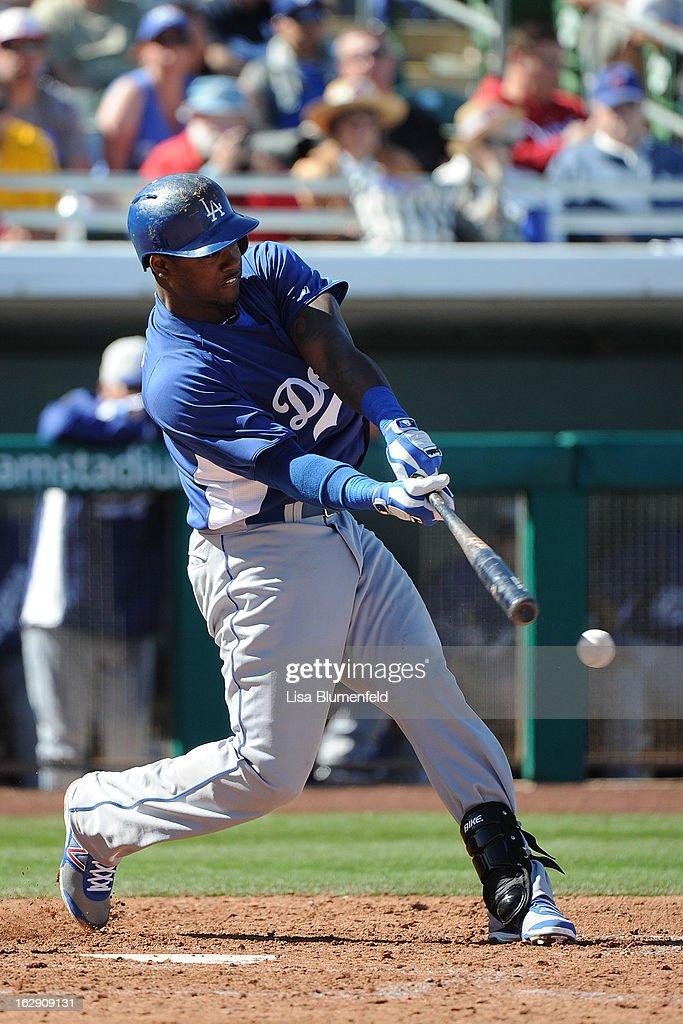 Hanley Ramirez #13 of the Los Angeles Dodgers bats against the Chicago Cubs on February 27, 2013 at HoHoKam Park in Mesa, Arizona.