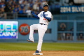 Hanley Ramirez of the Los Angeles Dodgers celebrates after hitting a double in the third inning against the Atlanta Braves during Game Three of the...