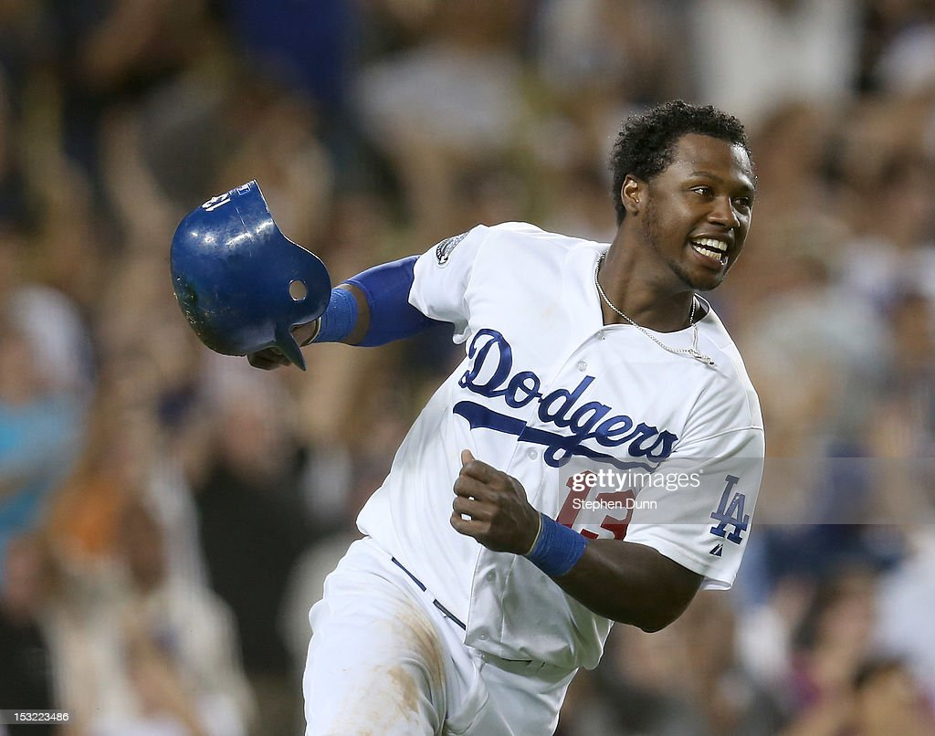 Hanley Ramirez #13 of the Los Angeles Dodgers celebrates after scoring the winning run on a walk off single in the ninth inning the San Francisco Giants on October 1, 2012 at Dodger Stadium in Los Angeles, California. The Dodgers won 3-2.
