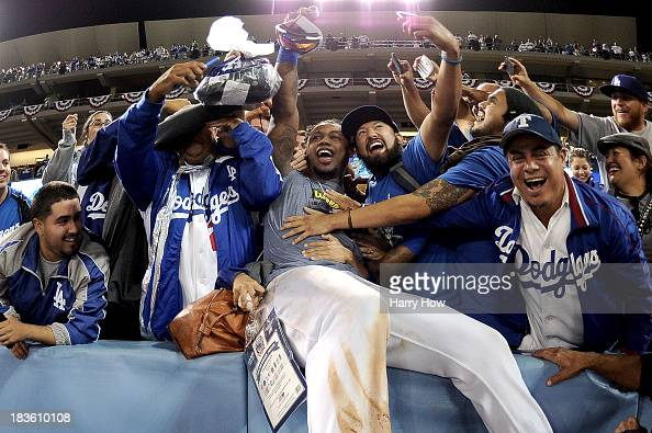 Hanley Ramirez of the Los Angeles Dodgers celebrates with fans after the Dodgers defeat the Atlanta Braves 43 in Game Four of the National League...