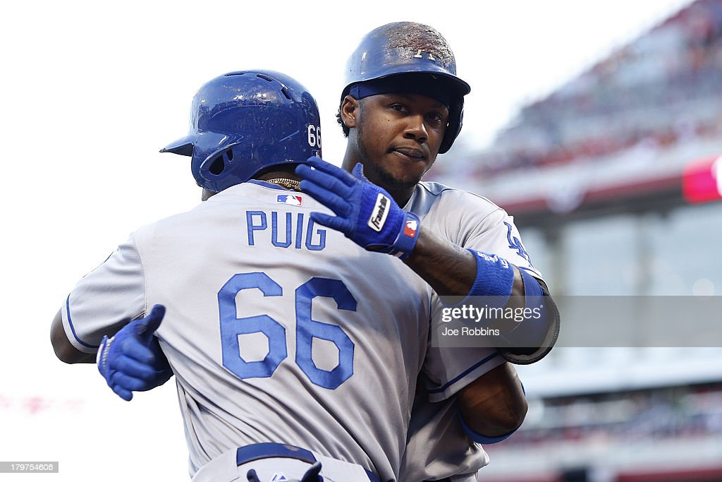 <a gi-track='captionPersonalityLinkClicked' href=/galleries/search?phrase=Hanley+Ramirez&family=editorial&specificpeople=538406 ng-click='$event.stopPropagation()'>Hanley Ramirez</a> #13 of the Los Angeles Dodgers celebrates with <a gi-track='captionPersonalityLinkClicked' href=/galleries/search?phrase=Yasiel+Puig&family=editorial&specificpeople=10484087 ng-click='$event.stopPropagation()'>Yasiel Puig</a> #66 after hitting a two-run home run in the first inning of the game against the Cincinnati Reds at Great American Ball Park on September 6, 2013 in Cincinnati, Ohio.