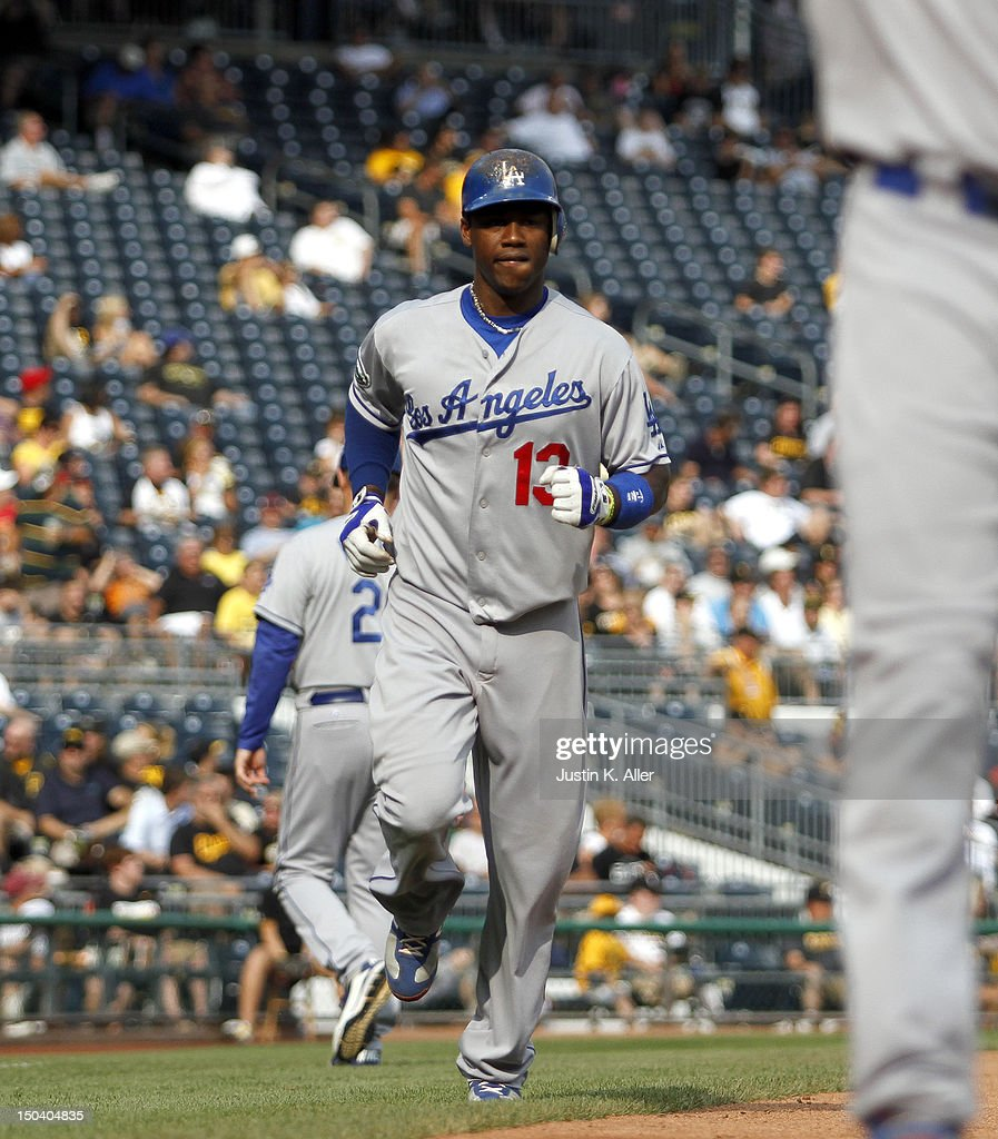 <a gi-track='captionPersonalityLinkClicked' href=/galleries/search?phrase=Hanley+Ramirez&family=editorial&specificpeople=538406 ng-click='$event.stopPropagation()'>Hanley Ramirez</a> #13 of the Los Angeles Dodgers comes home after hitting a two run home run in the fourth inning against the Los Angeles Dodgers during the game on August 16, 2012 at PNC Park in Pittsburgh, Pennsylvania.