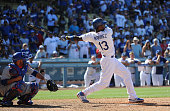 Hanley Ramirez of the Los Angeles Dodgers hits a RBI single in the ninth inning to defeat the Chicago Cubs 76 at Dodger Stadium on August 5 2012 in...