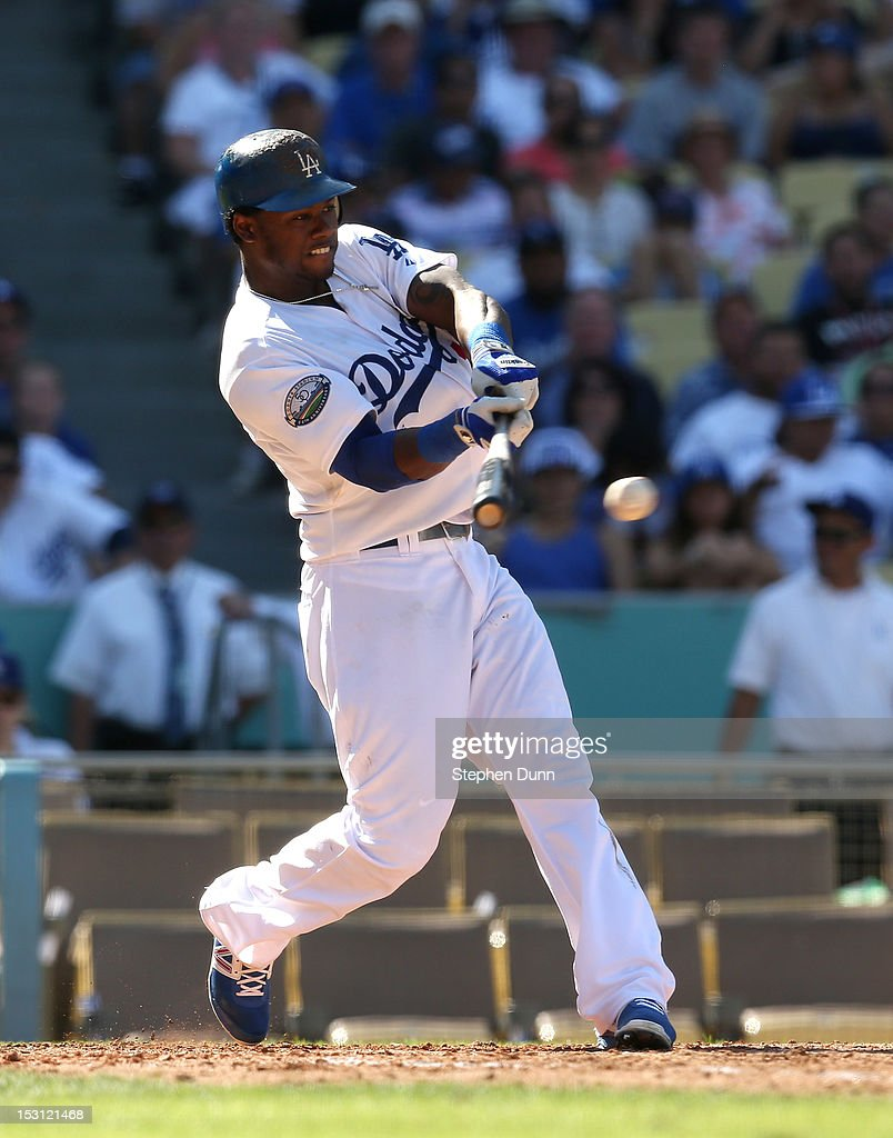 Hanley Ramirez #13 of the Los Angeles Dodgers hits an RBI single in the fifth inning against the Colorado Rockies on September 30, 2012 at Dodger Stadium in Los Angeles, California. The Dodgers won 7-1.