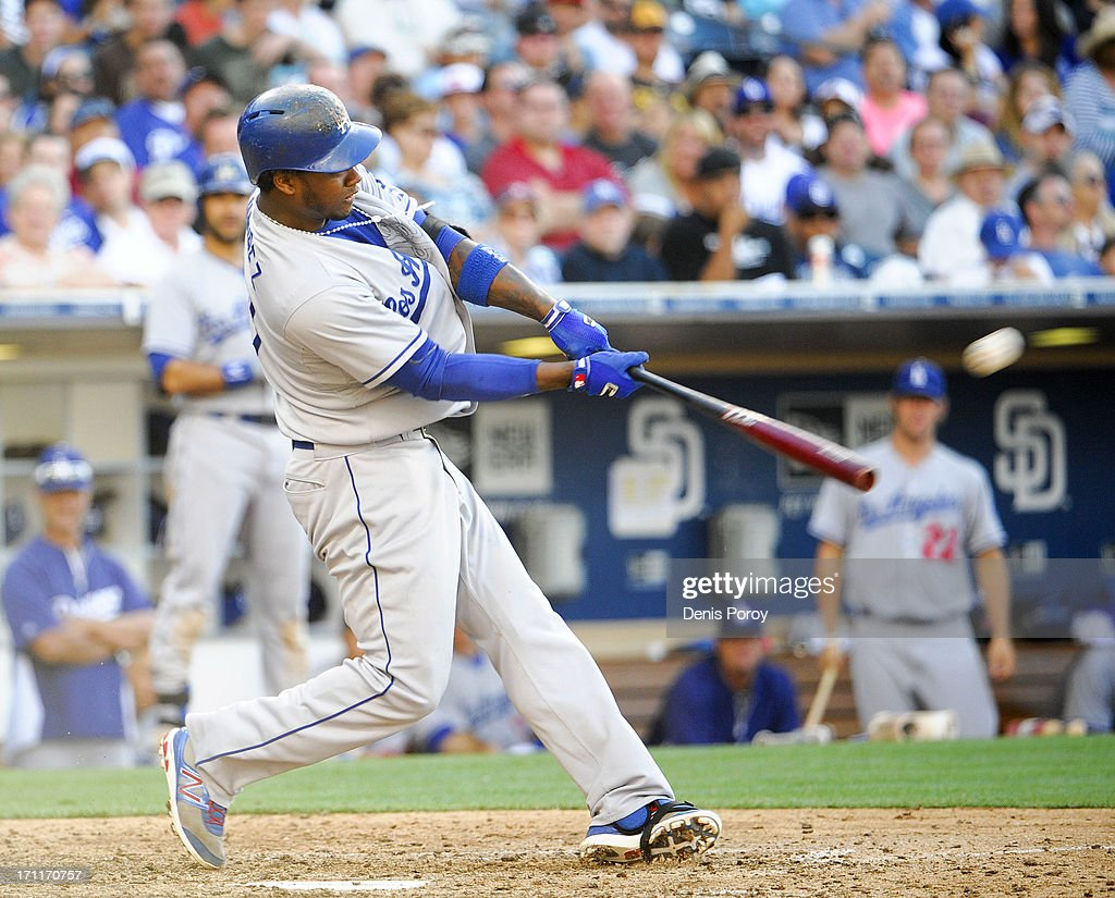 <a gi-track='captionPersonalityLinkClicked' href=/galleries/search?phrase=Hanley+Ramirez&family=editorial&specificpeople=538406 ng-click='$event.stopPropagation()'>Hanley Ramirez</a> #13 of the Los Angeles Dodgers hits solo home run during the seventh inning of a baseball game against the San Diego Padres at Petco Park on June 22, 2013 in San Diego, California.