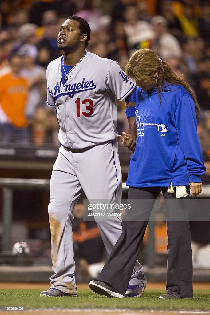 <a gi-track='captionPersonalityLinkClicked' href=/galleries/search?phrase=Hanley+Ramirez&family=editorial&specificpeople=538406 ng-click='$event.stopPropagation()'>Hanley Ramirez</a> #13 of the Los Angeles Dodgers is assisted off the field by trainer Sue Falsone after sustaining an injury against the San Francisco Giants during the sixth inning at AT&T Park on May 3, 2013 in San Francisco, California.