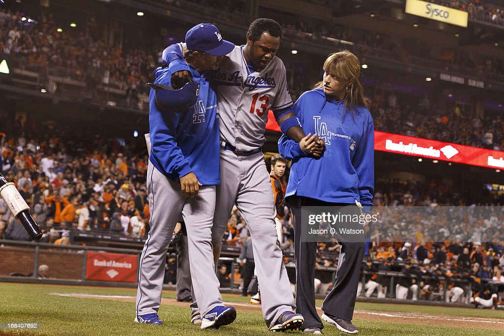 <a gi-track='captionPersonalityLinkClicked' href=/galleries/search?phrase=Hanley+Ramirez&family=editorial&specificpeople=538406 ng-click='$event.stopPropagation()'>Hanley Ramirez</a> #13 of the Los Angeles Dodgers is assisted off the field after sustaining an injury during the sixth inning against the San Francisco Giants at AT&T Park on May 3, 2013 in San Francisco, California. The San Francisco Giants defeated the Los Angeles Dodgers 2-1.