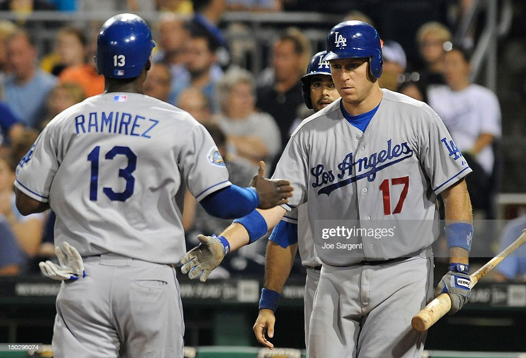 <a gi-track='captionPersonalityLinkClicked' href=/galleries/search?phrase=Hanley+Ramirez&family=editorial&specificpeople=538406 ng-click='$event.stopPropagation()'>Hanley Ramirez</a> #13 of the Los Angeles Dodgers is congratulated by A.J. Ellis #17 after scoring in the fourth inning against the Pittsburgh Pirates on August 14, 2012 at PNC Park in Pittsburgh, Pennsylvania. Los Angeles won the game 11-0.