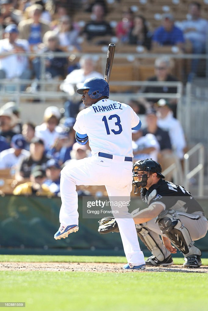 Hanley Ramirez #13 of the Los Angeles Dodgers kicks and prepares to swing the bat during their spring training baseball game against the Chicago White Sox at Camelback Ranch in February 23, 2013 in Glendale Arizona.