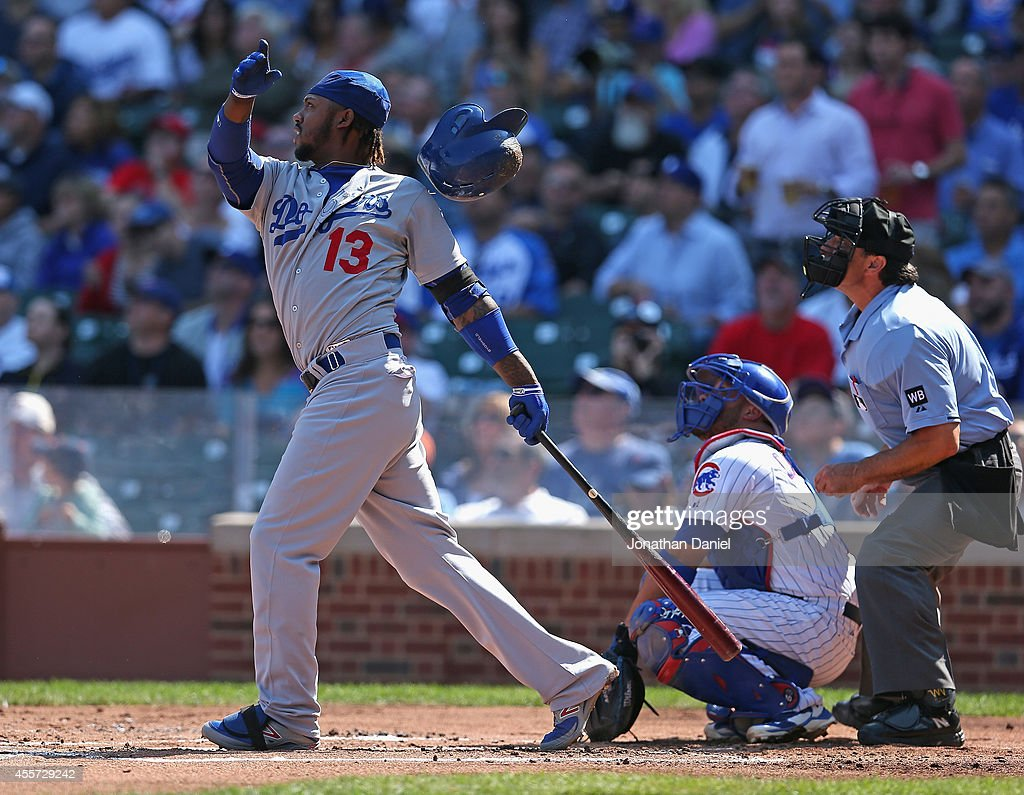Hanley Ramirez of the Los Angeles Dodgers loses his helmet as he hits a double in the 1st inning against the Chicago Cubsat Wrigley Field on...
