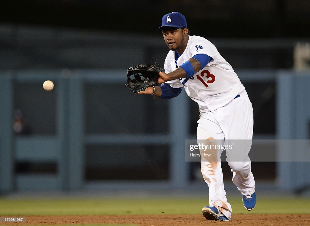 <a gi-track='captionPersonalityLinkClicked' href=/galleries/search?phrase=Hanley+Ramirez&family=editorial&specificpeople=538406 ng-click='$event.stopPropagation()'>Hanley Ramirez</a> #13 of the Los Angeles Dodgers makes a play on an Chris Stewart #19 of the New York Yankees groundball to end the seventh inning at Dodger Stadium on July 30, 2013 in Los Angeles, California.