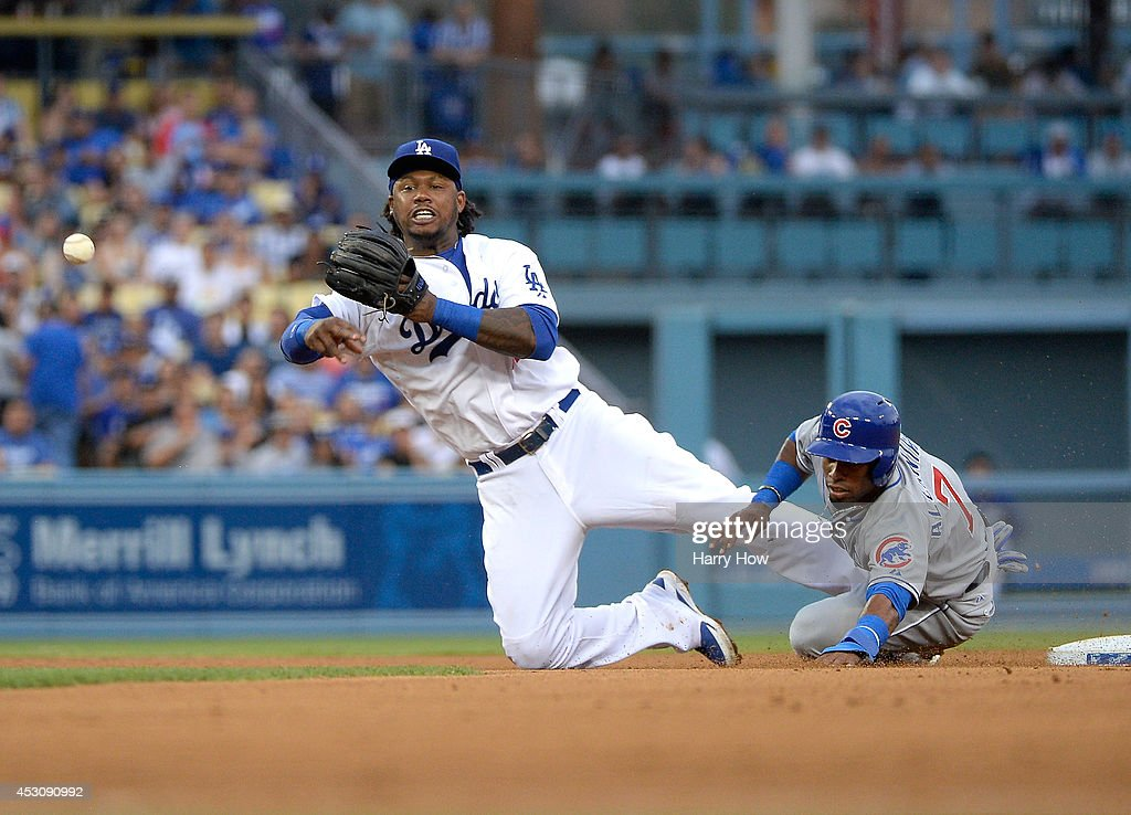 <a gi-track='captionPersonalityLinkClicked' href=/galleries/search?phrase=Hanley+Ramirez&family=editorial&specificpeople=538406 ng-click='$event.stopPropagation()'>Hanley Ramirez</a> #13 of the Los Angeles Dodgers makes a throw in front of Arismendy Alcantara #7 of the Chicago Cubs in an attepmt for a double play during the third inning at Dodger Stadium on August 2, 2014 in Los Angeles, California.