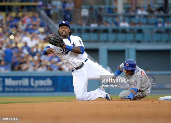 Hanley Ramirez of the Los Angeles Dodgers makes a throw in front of Arismendy Alcantara of the Chicago Cubs in an attepmt for a double play during...