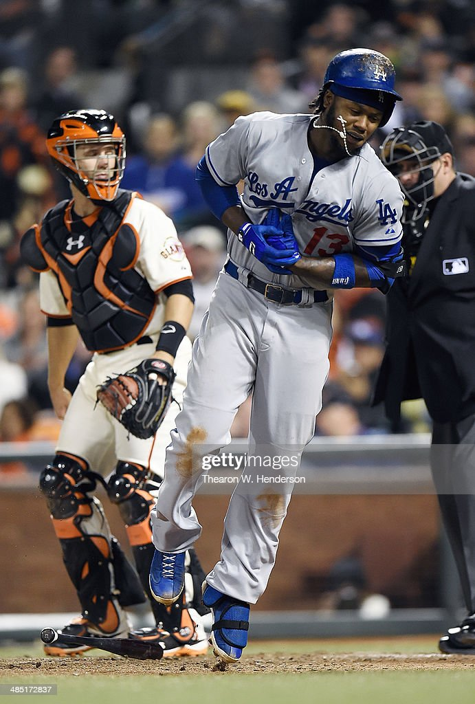 <a gi-track='captionPersonalityLinkClicked' href=/galleries/search?phrase=Hanley+Ramirez&family=editorial&specificpeople=538406 ng-click='$event.stopPropagation()'>Hanley Ramirez</a> #13 of the Los Angeles Dodgers reacts after he was hit in the hand with a pitch from Ryan Vogelsong #32 of the San Francisco Giants (not pictured) in the top of the seventh inning at AT&T Park on April 16, 2014 in San Francisco, California.