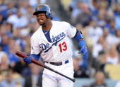 Hanley Ramirez of the Los Angeles Dodgers reacts as he is at bat in the first inning against the St Louis Cardinals in Game Four of the National...