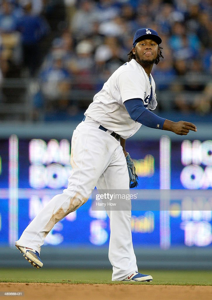Hanley Ramirez #13 of the Los Angeles Dodgers reacts as he throws out Trevor Cahill #35 of the Arizona Diamondbacks during the seventh inning at Dodger Stadium on April 19, 2014 in Los Angeles, California.