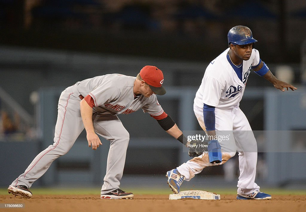<a gi-track='captionPersonalityLinkClicked' href=/galleries/search?phrase=Hanley+Ramirez&family=editorial&specificpeople=538406 ng-click='$event.stopPropagation()'>Hanley Ramirez</a> #13 of the Los Angeles Dodgers reacts to his double in front of <a gi-track='captionPersonalityLinkClicked' href=/galleries/search?phrase=Zack+Cozart&family=editorial&specificpeople=6889199 ng-click='$event.stopPropagation()'>Zack Cozart</a> #2 of the Cincinnati Reds during the sixth inning at Dodger Stadium on July 26, 2013 in Los Angeles, California.