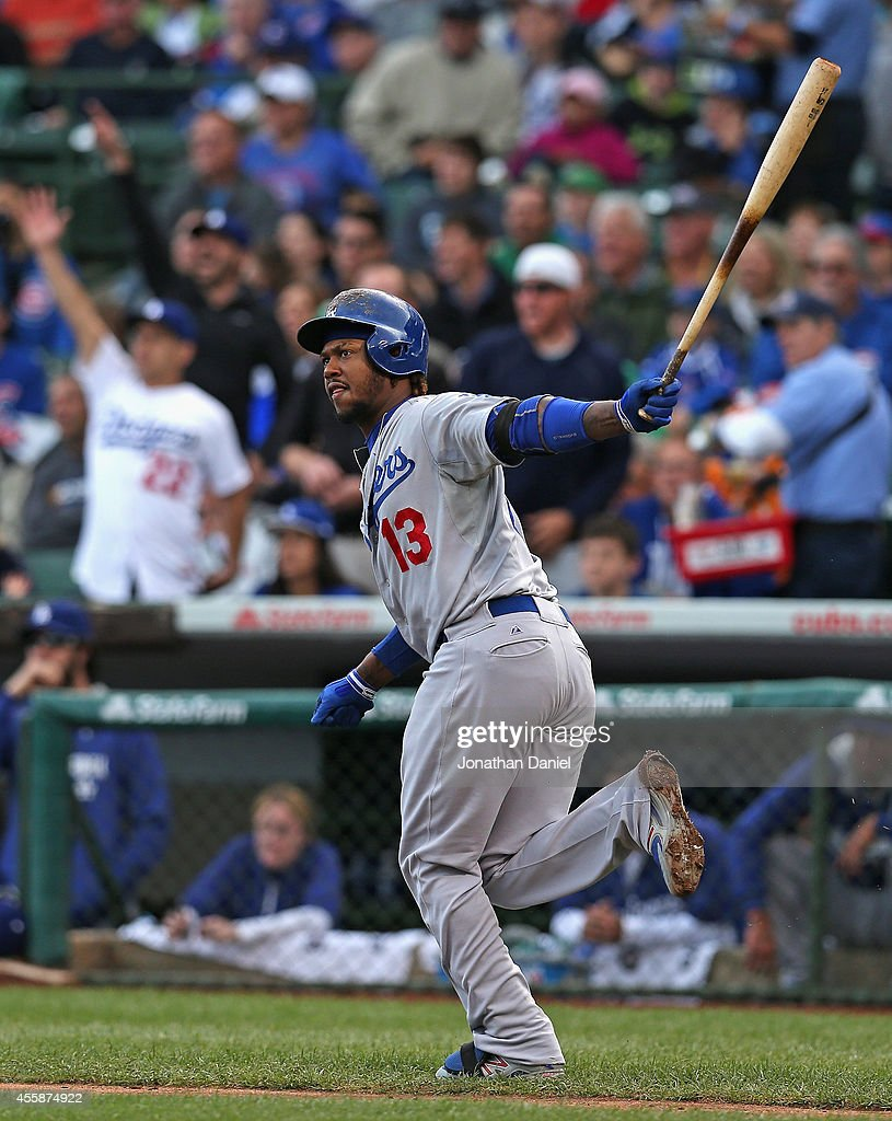 Hanley Ramirez #13 of the Los Angeles Dodgers runs down the first base line as he follows the flight of his double in the 1st inning against the Chicago Cubs at Wrigley Field on September 21, 2014 in Chicago, Illinois.