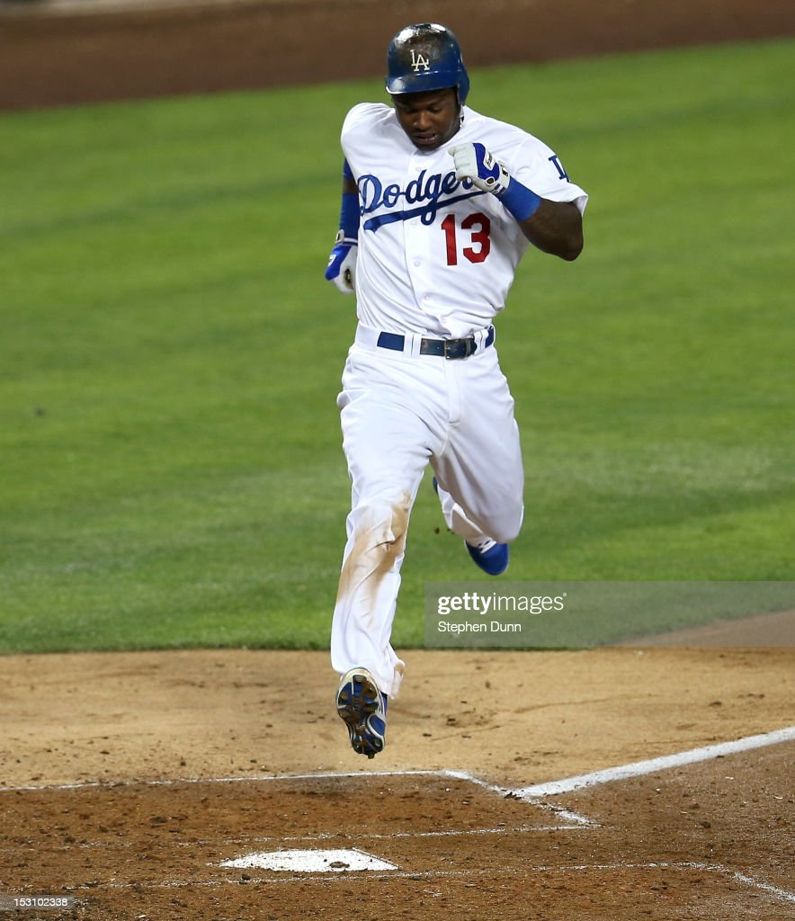 <a gi-track='captionPersonalityLinkClicked' href=/galleries/search?phrase=Hanley+Ramirez&family=editorial&specificpeople=538406 ng-click='$event.stopPropagation()'>Hanley Ramirez</a> #13 of the Los Angeles Dodgers scores a run on a single by A.J. Ellis in the fourth inning against the Colorado Rockies on September 29, 2012 at Dodger Stadium in Los Angeles, California.